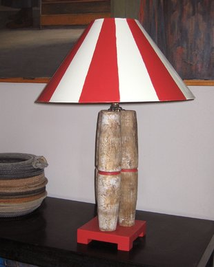 Distressed Candlepins Produce a Rustic Table Lamp