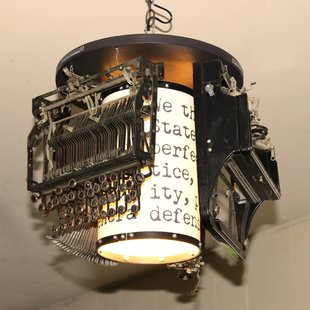 Dissected Royal Portable Standard Model O Reconstructed into Quirky Ceiling Light.